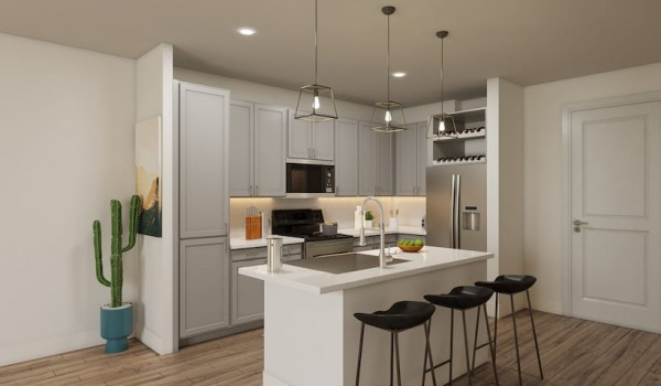 rendering of kitchen area that includes a large, spacious island and connects to the living area and bedroom